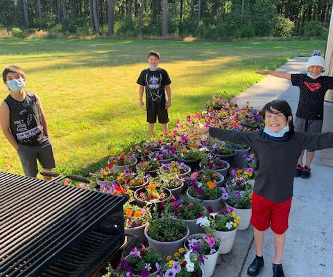 Youth make flower pots for Elders.